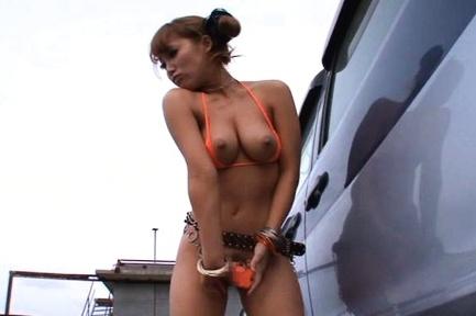 Mao kurata asian exposes big hot tits and vagina behind a car. Mao Kurata Asian exposes voluminous hot breasts and cunt behind a car
